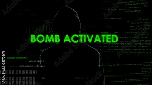 Photo  Faceless male hacker remotely activating bomb, terrorism, cyber crime concept