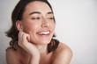 Leinwanddruck Bild Portrait of cheerful smiling female on white