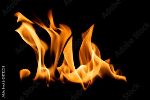 Bright orange flame isolated on black background