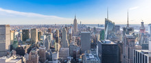 Panoramic Photo Of New York City Skyline In Manhattan Downtown With Empire State Building And Skyscrapers On Sunny Day With Clear Blue Sky USA