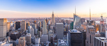 Panoramic Photo Of New York City Skyline In Manhattan Downtown With Empire State Building And Skyscrapers At Sunset USA
