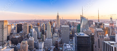 Foto auf Leinwand New York Panoramic photo of New York City Skyline in Manhattan downtown with Empire State Building and skyscrapers at sunset USA
