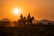Silhouette Two Cowboys Ride Wi...