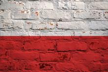 Polish Flag On Brick Wall Background.