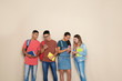 Group of teenagers on color background. Youth lifestyle and friendship
