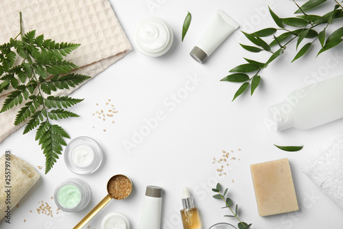 Flat lay composition with different body care products and space for text on white background