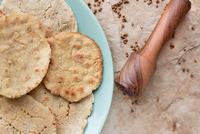 Corn Tortilla With Coriander And Mortar For Grinding On A Stone Background