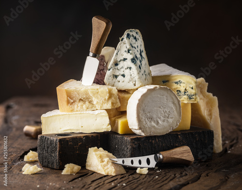 Fototapeta Assortment of different cheese types on wooden background. Cheese background. obraz