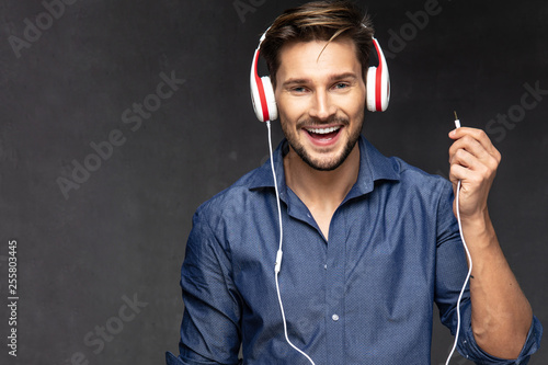 Happy Young Man With Headphones Listening Music Buy This