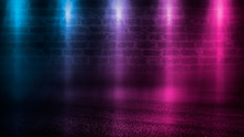 Empty Scene Background. Empty Brick Wall, Concrete Floor, Spotlight, Multicolored Neon Rays, Bokeh.