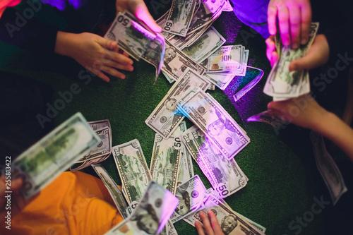 Vászonkép paper money in female hands on green background.