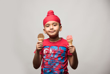 Indian Sikh/punjabi Small Boy Eating Ice Cream In Cone, Isolated Over White Background