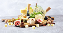 Cheese Plate Served With Figs, Various Cheese On A Platter On Wood