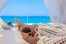 Beautiful Young Woman Enjoying A Cocktail In A Cabana