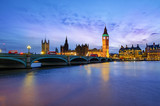 Fototapeta Big Ben - London cityscape with Big Ben and City of Westminster Abbey bridge illuminated in evening light, in England