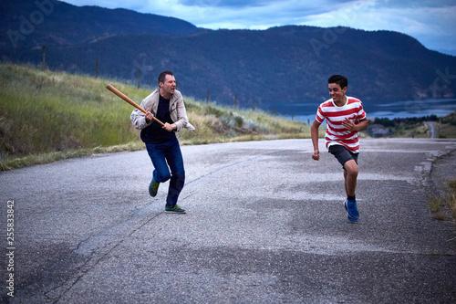 Fototapeta two young men fun chase run