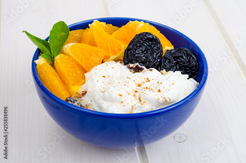 Blue plate with natural yogurt, orange  Diet menu  - Buy