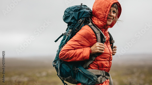 Fototapeta Portrait of a woman on a hiking adventure obraz