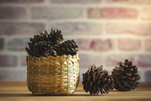 Pine Cone In Bamboo Basket On ...