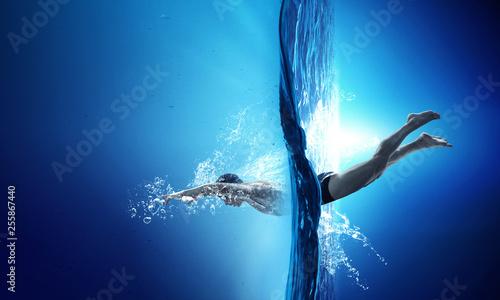 Valokuva  Swimmer at competition. Mixed media