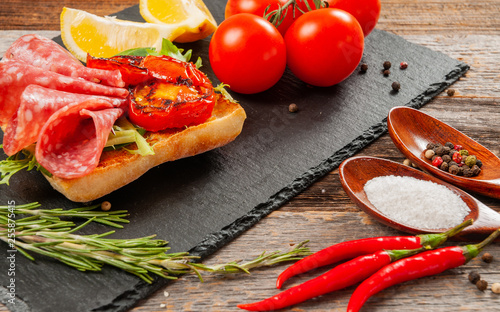 Fotografie, Obraz  Healthy Breakfast. Fresh sandwich with salami and tomato.