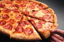 Taking Slice Of Pepperoni Pizz...