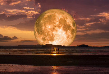 super full moon on the beach and family, Elements of this image furnished by NASA