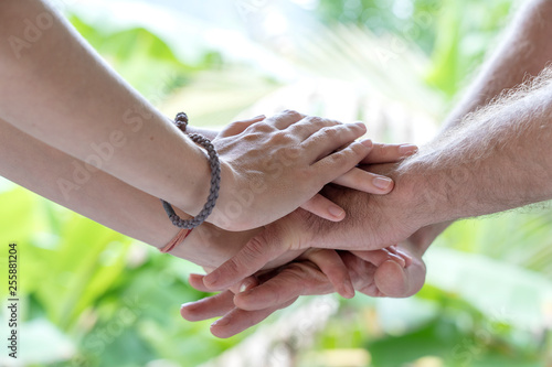 Many hands getting together in the center of a circle Canvas Print