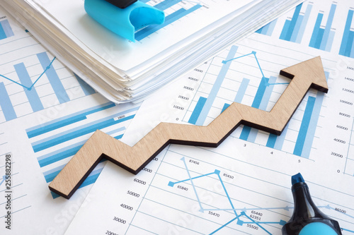 Fototapeta Business growth concept. Financial report with graphs and arrow. obraz