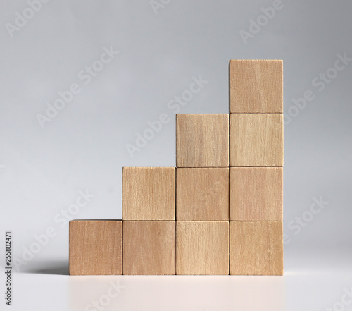 Valokuva A stack of wooden blocks stacked in the shape of a staircase.