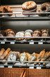 freshly baked bread with a delicious crust on the counter in a bakery or shop. background of bakery products