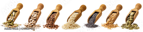 Fotografia Scoop with seeds of pumpkin, the flax, sesame of sunflower and poppy isolated on a white background