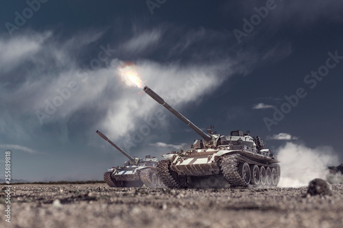 Fotografija  two military tanks attacking and shooting