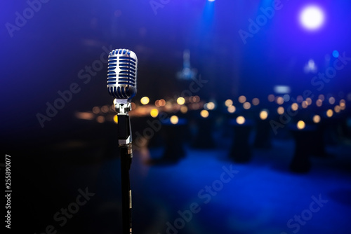 Fotografiet stylish 50s or 60s retro rock microphone on an empty venue stage