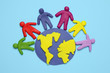 Plasticine figurines of people of different races are on planet earth. A variety of interactions, communication and globalization. Cartoon art.