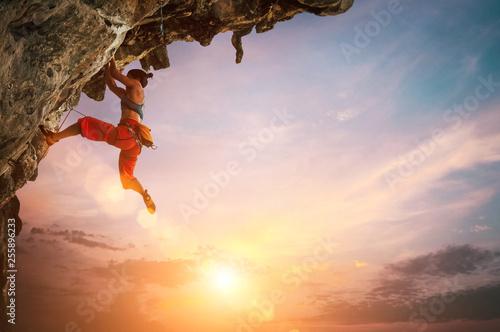 Fototapeta  Woman climbing on rock