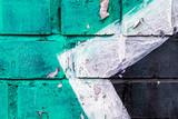 Fototapeta Młodzieżowe - Graffiti painted on a brick wall texture.