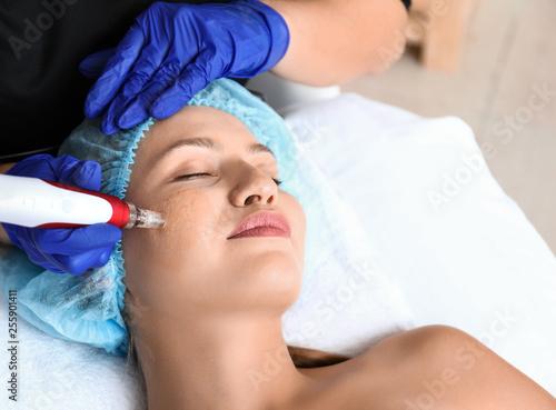 Fotografie, Obraz  Young woman undergoing procedure of bb glow treatment in beauty salon