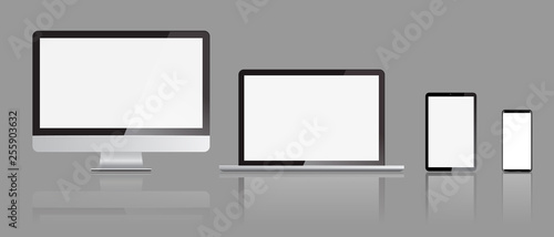 Foto  Set of realistic Monitors laptop tablet and smartphone display mockups with front view