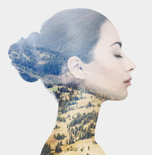 Double Exposure Of Female Face And Rocky Landscape
