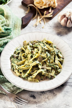 Tagliatelle Pasta With Spinach And Mushrooms On A Plate