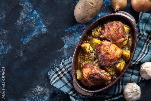 Fotomural Roasted chicken thighs and potatoes