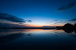 Sunset over lake with refleсted sky