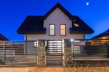 New House With Stone Fence Illuminated At Night, Poland