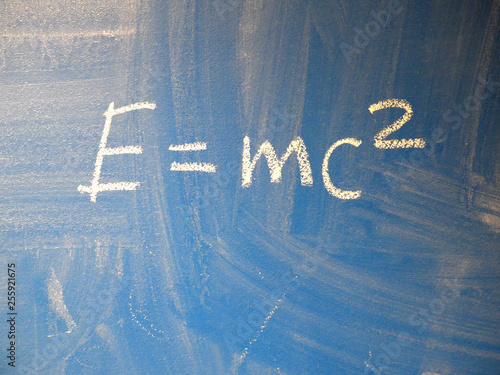 Mathematical formula e=mc2 squared written on a blue, relatively dirty chalkboard by chalk Canvas Print