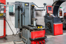 A Close-up Of A Modern Tire Changer With An Electronic Control System Stands In The Background Of A Workshop For Car Repair And Tire Fitting. Machine For Replacing And Balancing Car Tires