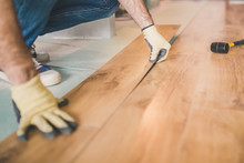 Professional Flooring Installation - Laying A New Laminate With A Wooden Pattern