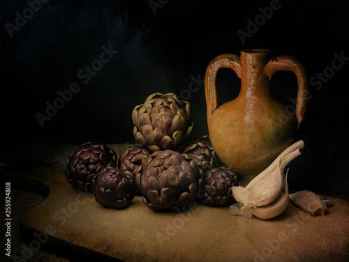 Fotografía  Raw artichokes, Mediterranean vegetable, on rustic hessian with garlic and terracotto amphora urn