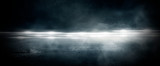 Fototapeta Abstract - Wet asphalt, reflection of neon lights, a searchlight, smoke. Abstract light in a dark empty street with smoke, smog. Dark background scene of empty street, night view, night city.