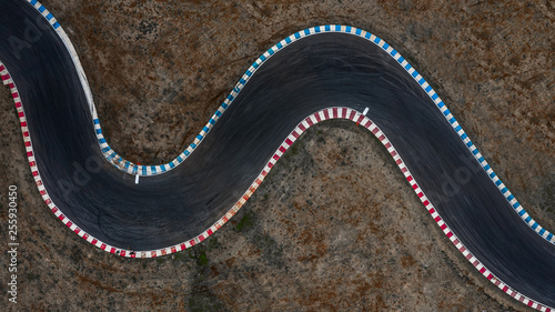 Fotobehang F1 Curving race track view from above, Aerial view car race asphalt track and curve.